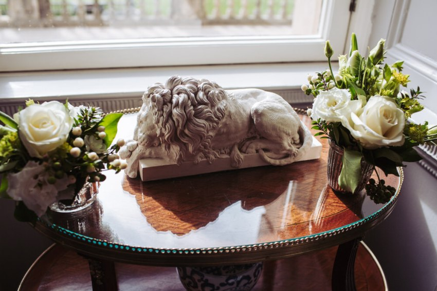 Wedding flowers and lion sculpture.