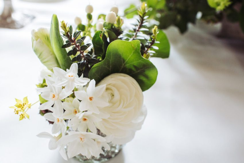 Miniature white narcissus and ivy wedding flowers.