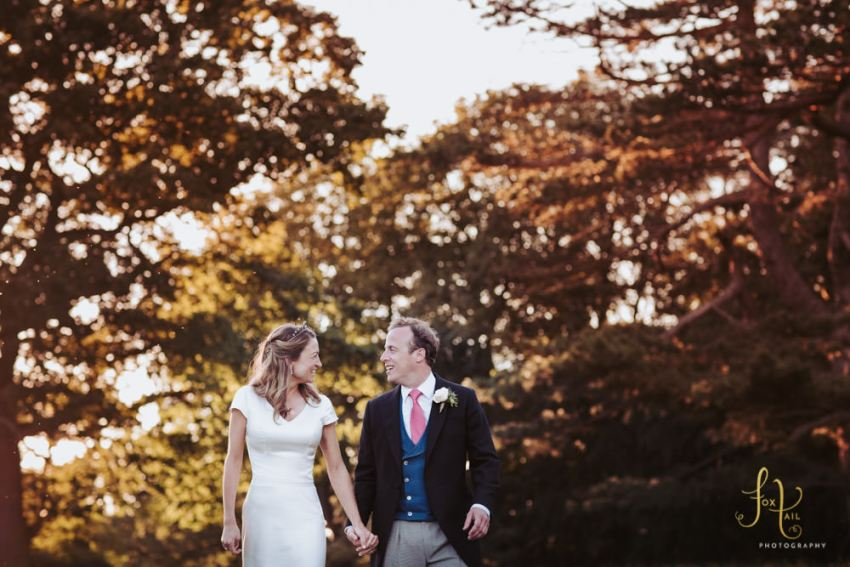 Knaresborough wedding photographer | Bride and groom hold hands