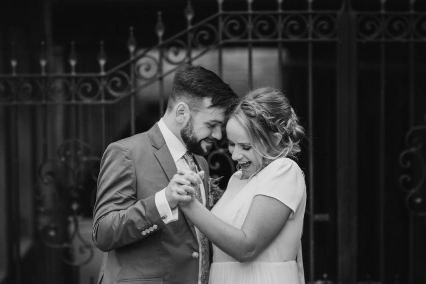 Bride and groom dance together at the Arches in Halifax