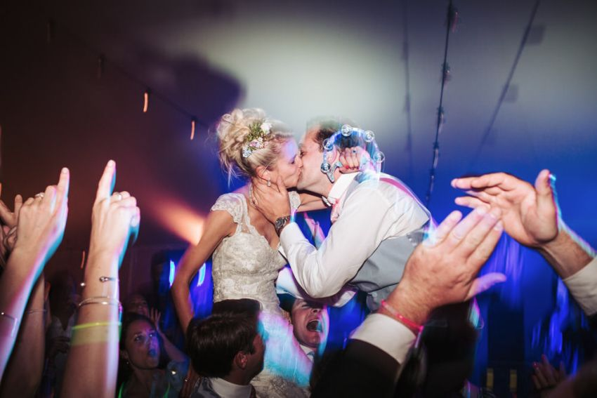 Harrogate wedding party photography. Bride and groom kiss on the dance floor.