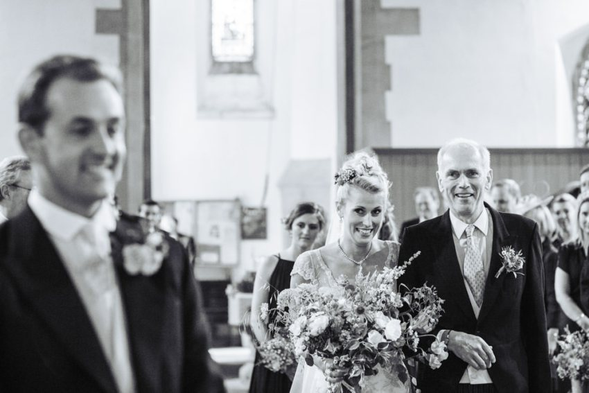 Bride being walked down the isle by her dad. Harrogate church wedding photography. Staveley.