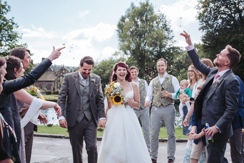 Guests throw confetti over newly weds at St Mary The Virgin church in Riddlesden.