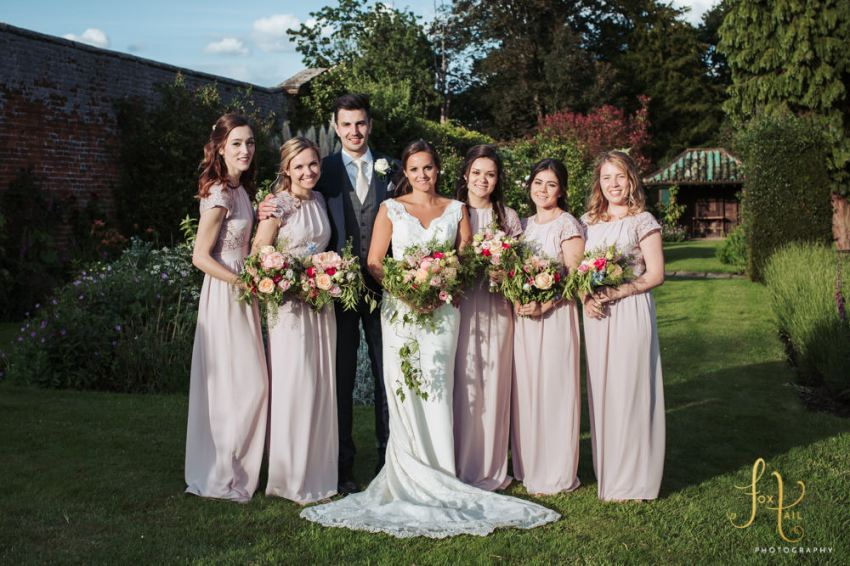 Bride, groom and bridesmaids in the gardens.