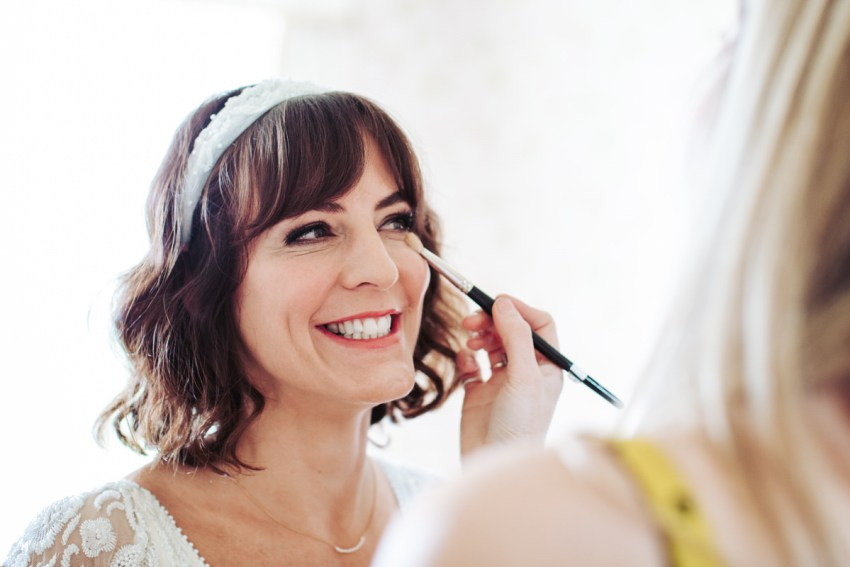 Bride having makeup done.