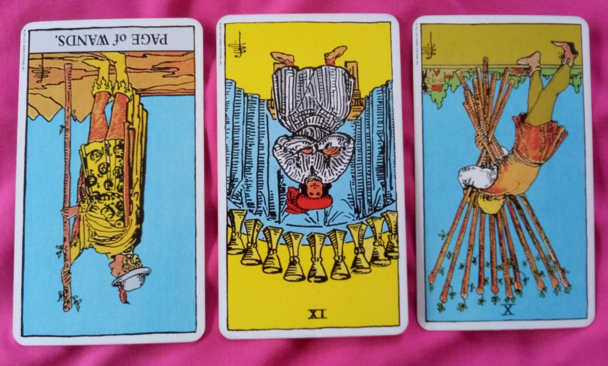 daily online tarot reading cards: The Page of Wands reversed, the 9 of Cups reversed, the 10 of Wands reversed