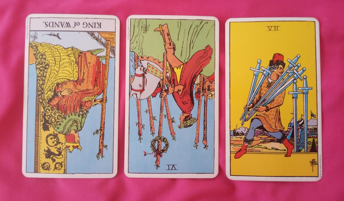 daily online soul purpose tarot reading cards: King of Wands reversed, 6 of Wands reversed 7 of Swords