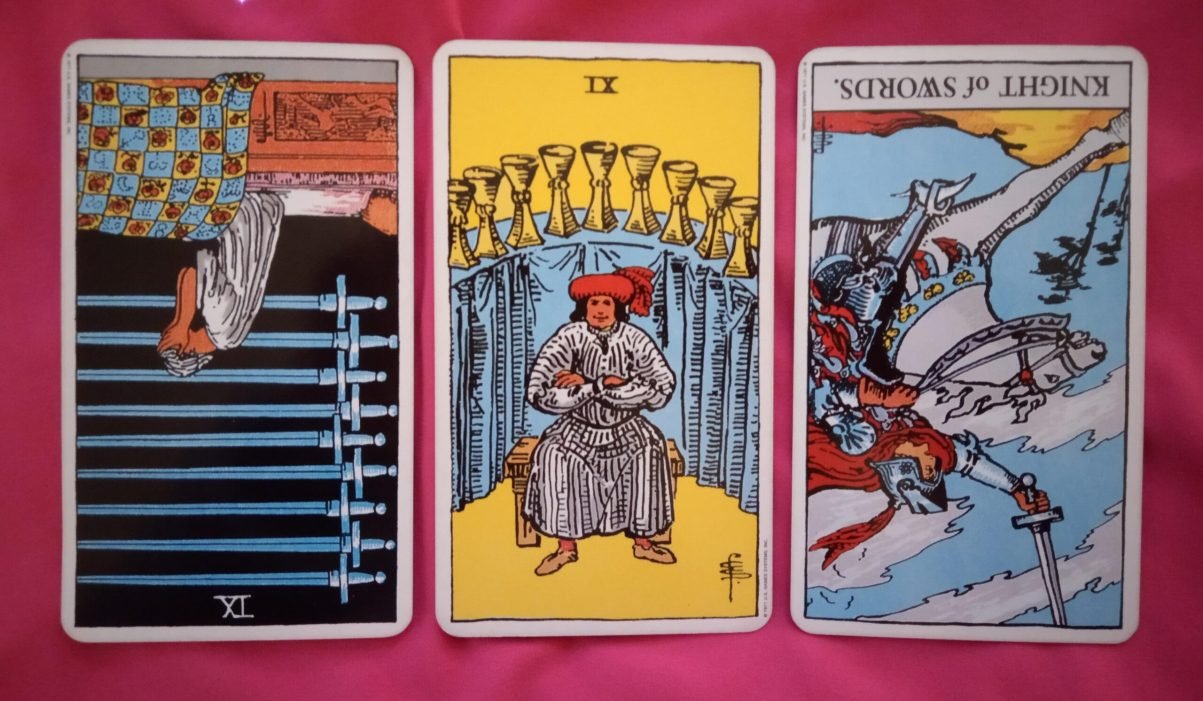 daily online tarot reading cards: 9 of Swords reversed, 9 of Cups, Knight of Swords reversed