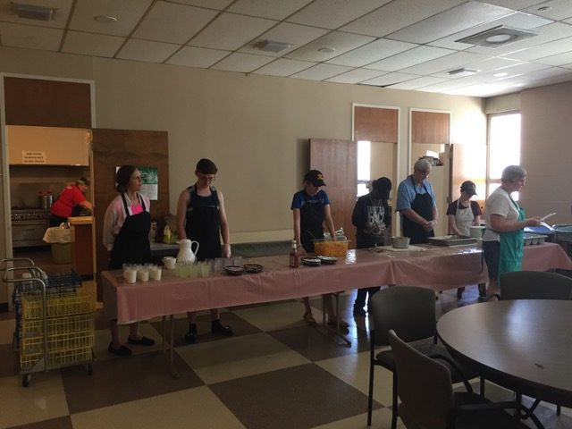 serving food at Sunday Evening Meals