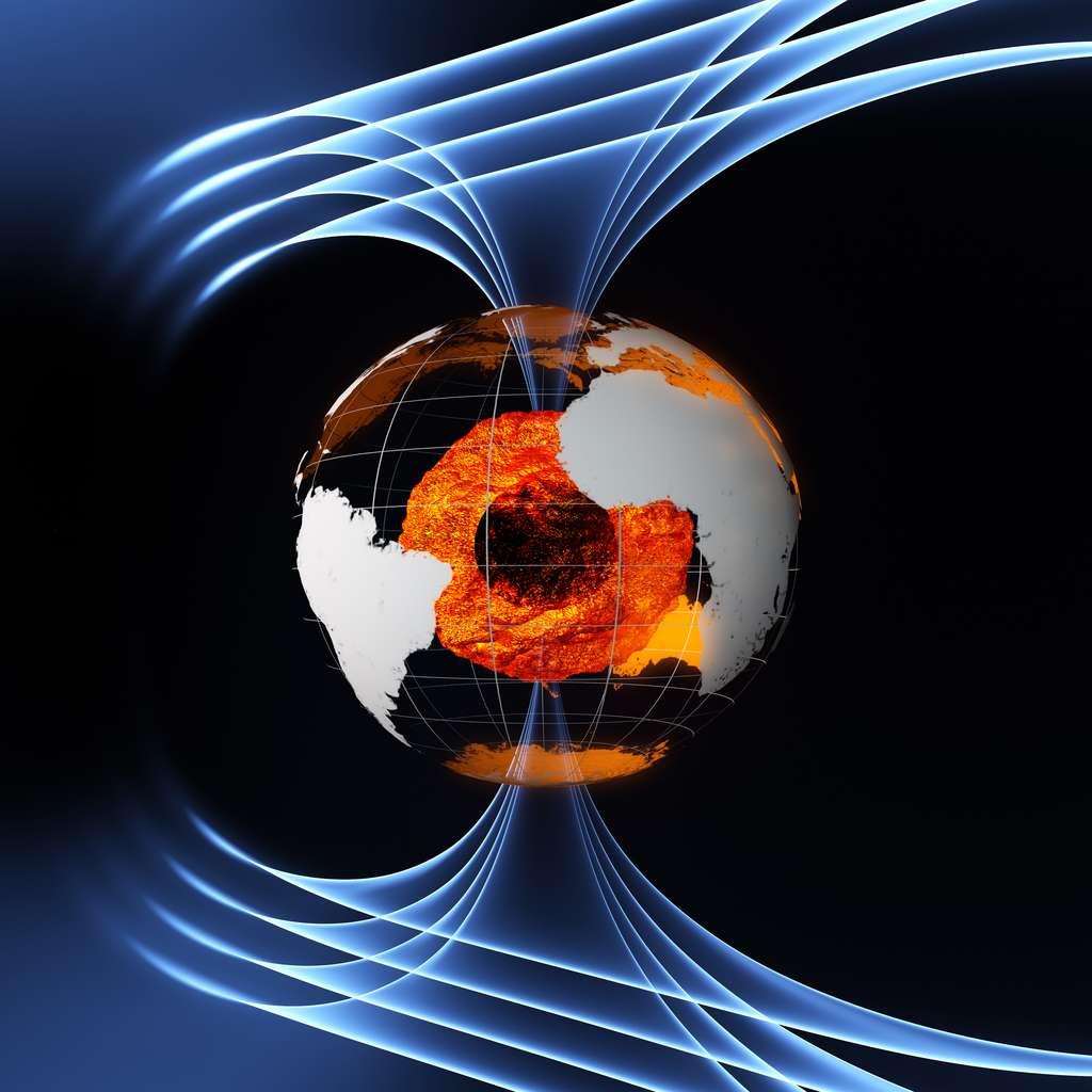 Une vue d'artiste de l'intérieur de la Terre et des lignes de champs de sa magnétosphère. Les couches supérieures du noyau sont très chaudes et liquides. La graine, au centre, est solide mais sa température peut atteindre celle de la surface du soleil. © ESA/AOES Medialab