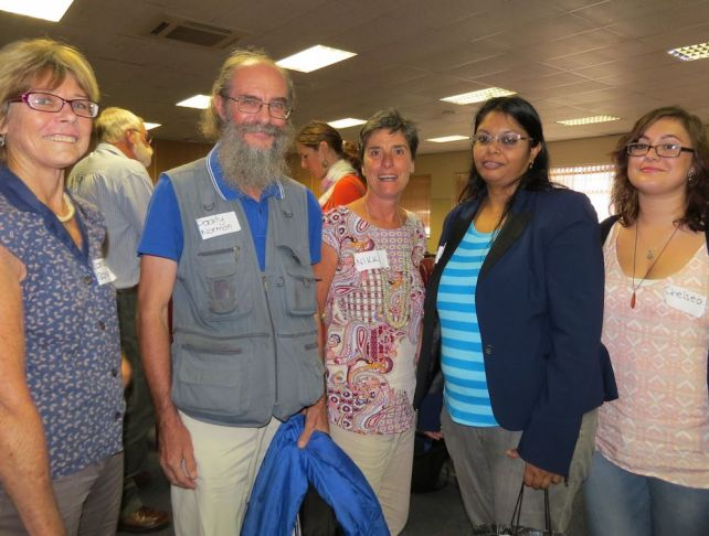 Namisha Muthraparsad (in turquoise stripes) DWS chats to delegates at Unconventioanl Gas seminar