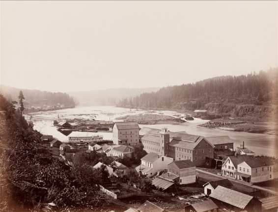 Albumen photograph of a town located on a wide riverbank
