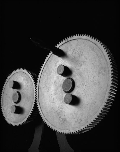 Black-and-white photograph of two interlocked metal gears
