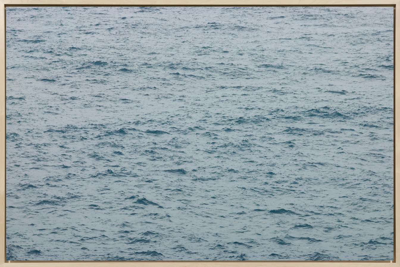 Framed color photograph of the surface of the sea