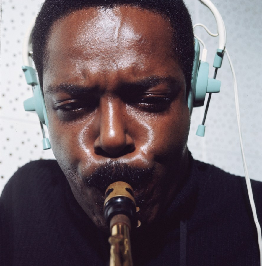 Color photograph up close of a man playing saxophone