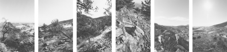 Six vertical black and white photographs of a rocky landscape at a tilted angle with trees against a brightly lit sky.