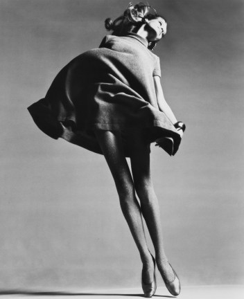 Black-and-white photograph of a woman with her dress billowing mid-dance