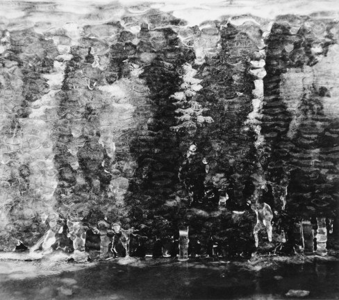 Black-and-white photograph of water trickling into a rippling pool