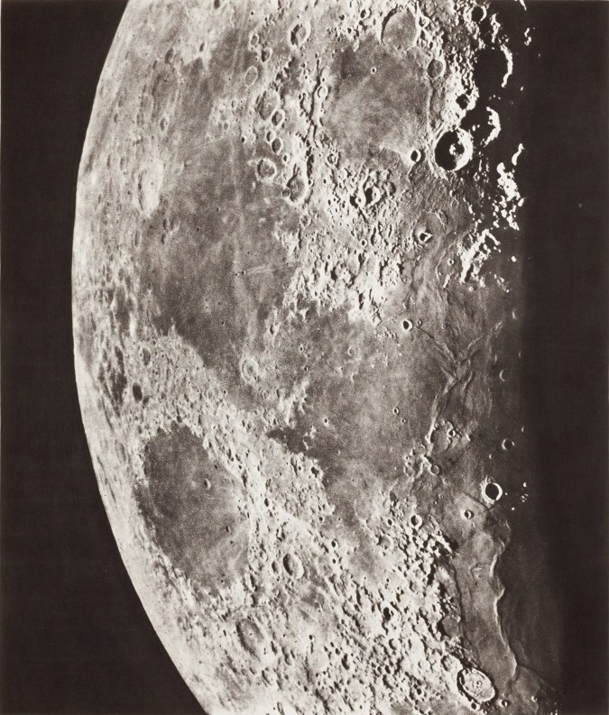 Sepia photogravure of the surface of the moon.