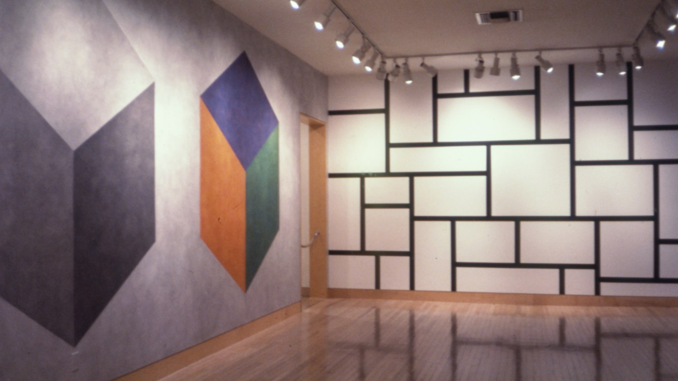 Installation photograph of two geometric wall drawings in a gallery
