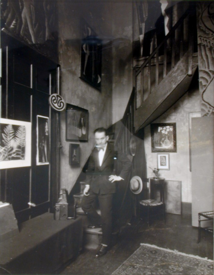 Black and white photograph of a man descending a staircase