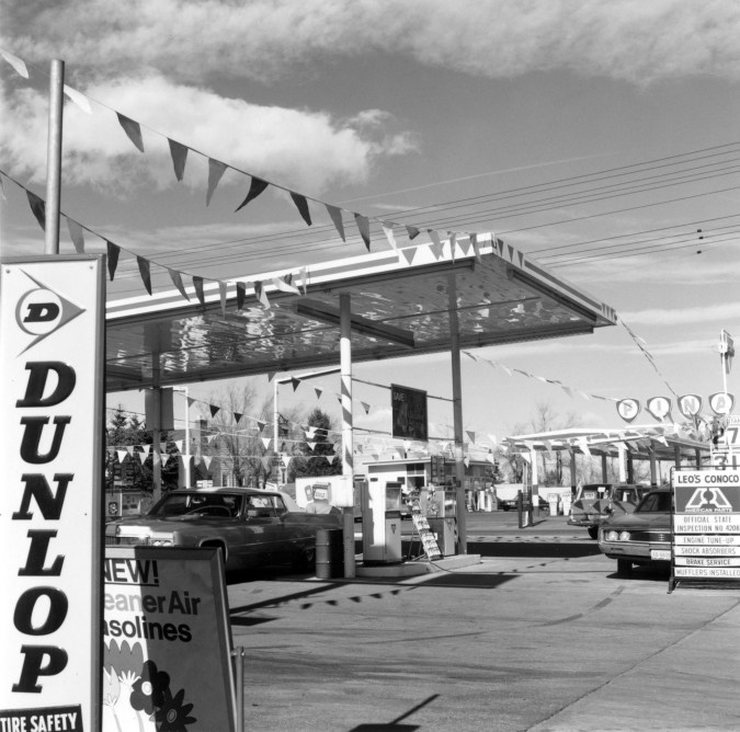 Black and white photograph of a gas station
