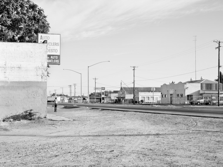 Man Walks Alone Through Empty Lot, Intersection of South 9th Street and River Road, Modesto, CA, 2012
