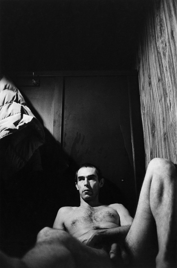 Black-and-white photograph of the photographer reclining in a bath