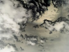 Inverted color photograph of a cloudy sky