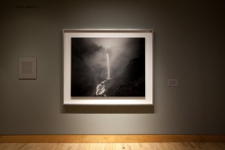 Installation photograph of a framed print of a waterfall