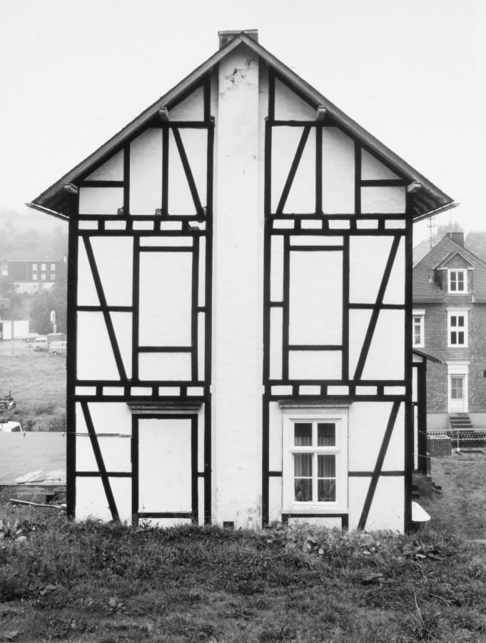 black and white photograph of a house facade