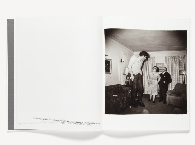 Open book of black and white photographs