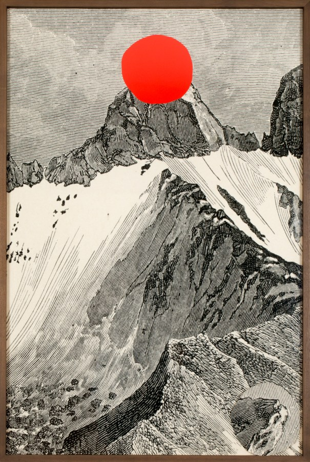 A framed etching of a mountain, the peak of which has been cut out and left in the bottom of the frame.