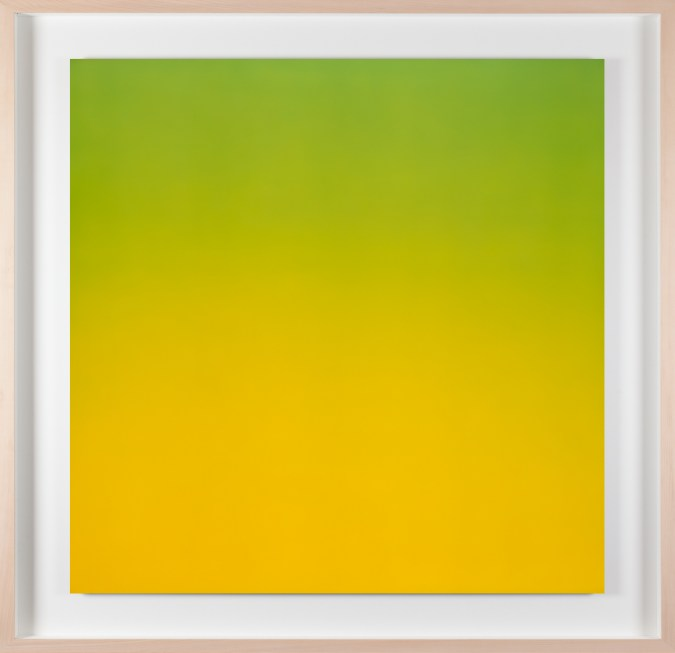 A framed photograph of a color field gradient going from green at the top to yellow at the bottom