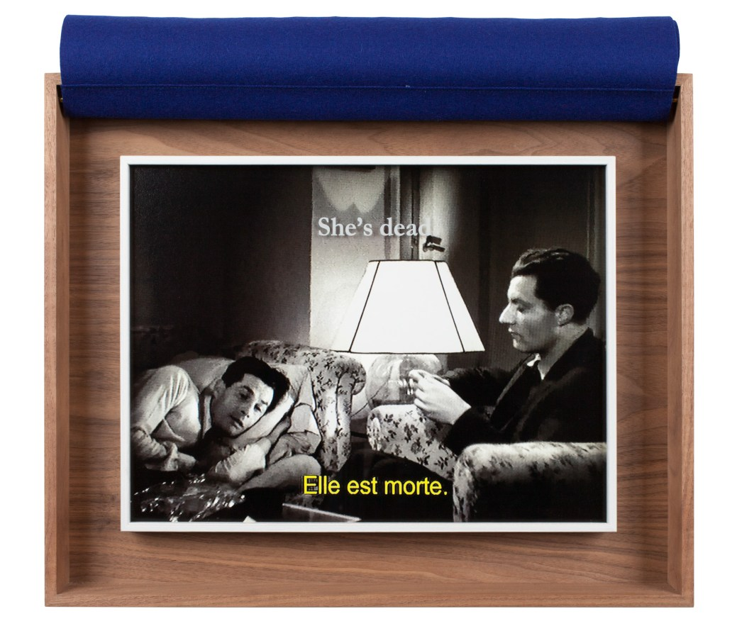 A wooden box with a photograph from a black and white movie inside