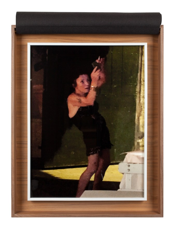 A wooden box with a photograph inside of a woman