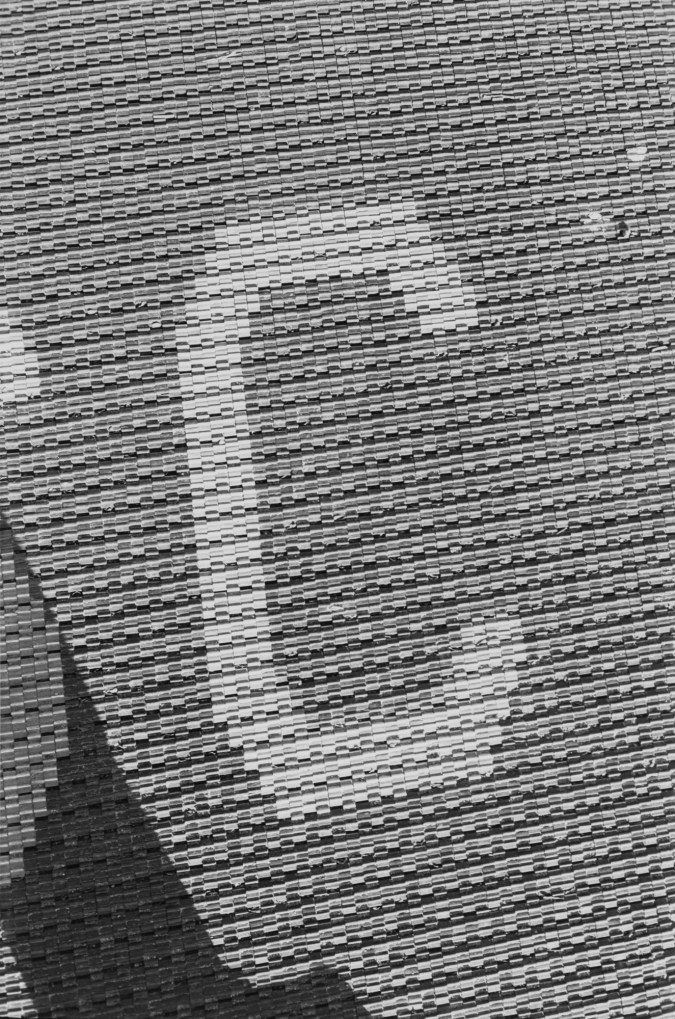 Black and white photograph of a detail of text in a tile floor