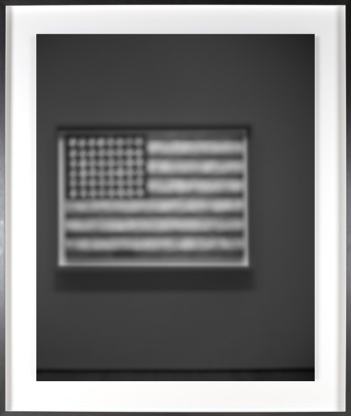 Black-and-white photograph of out of focus painting of an American flag