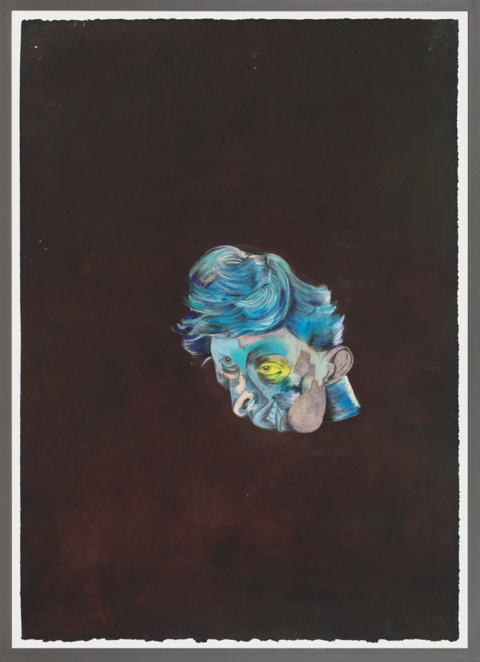 A framed drawing of an abstract blue and pink face.