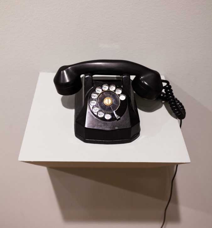 Photograph of a sculpture of a rotary phone