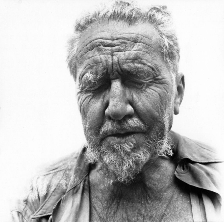 black and white photograph of a head and shoulders portrait of a man with his eyes closed.