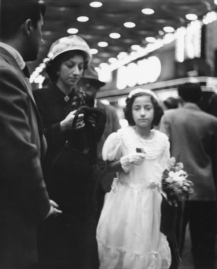 black and white photograph of a woman in a dark dress and a young girl in a white dress.