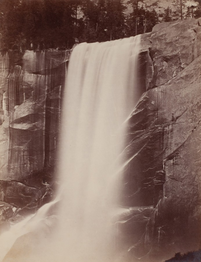 Ninteteenth century photograph of a large waterfall, coming off a cliff