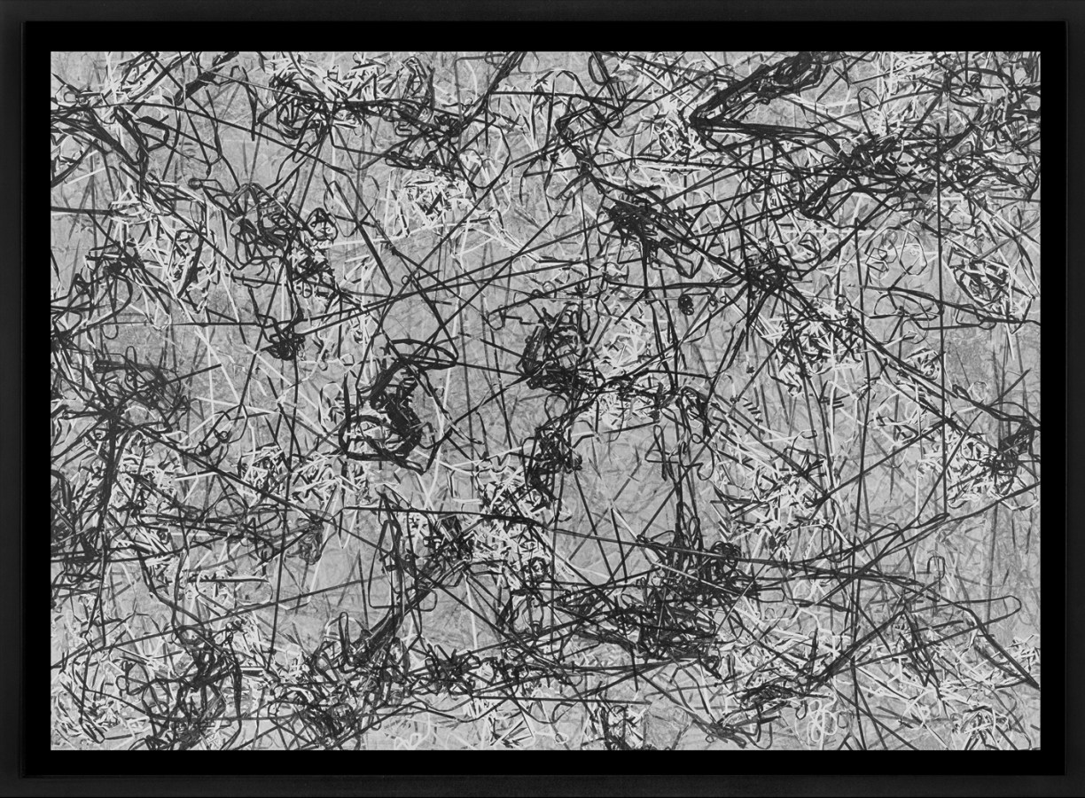 Black and white photograph of outlines of tangled cassette tape