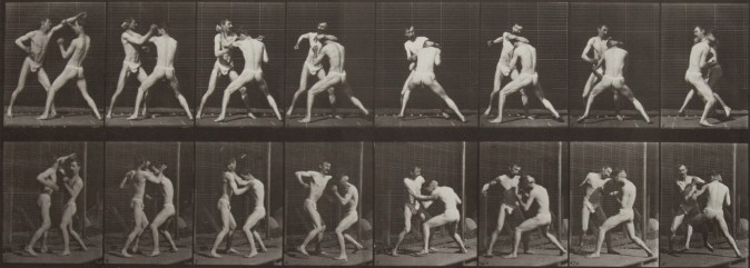 Sepia toned photograph with a grid of 16 panels showing two men in loin cloths boxing.