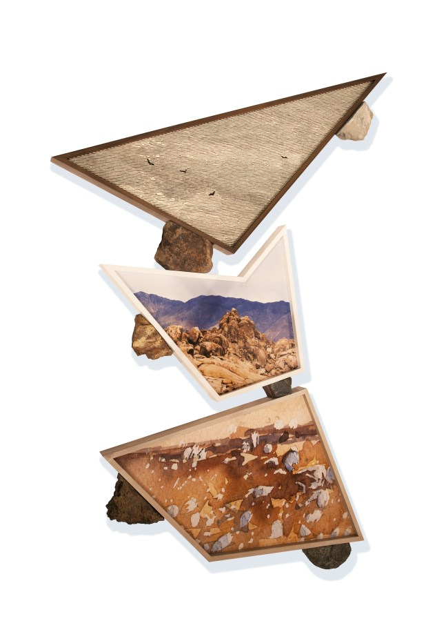 Three irregularly shaped framed images of rocky landscapes stacked on top of one another supported by pieces of cut rock