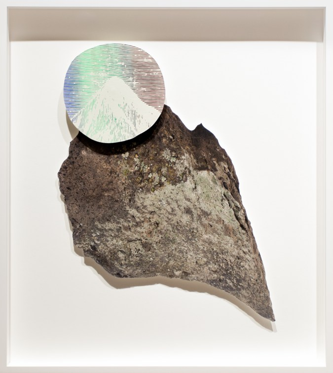 Collage of a rock with an iridescent circle imprinted with a mountain peak overlaid