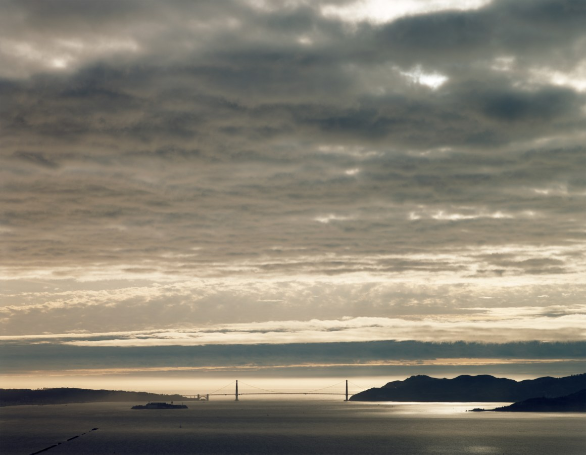 Color photograph of clouds over the Golden Gate Bridge