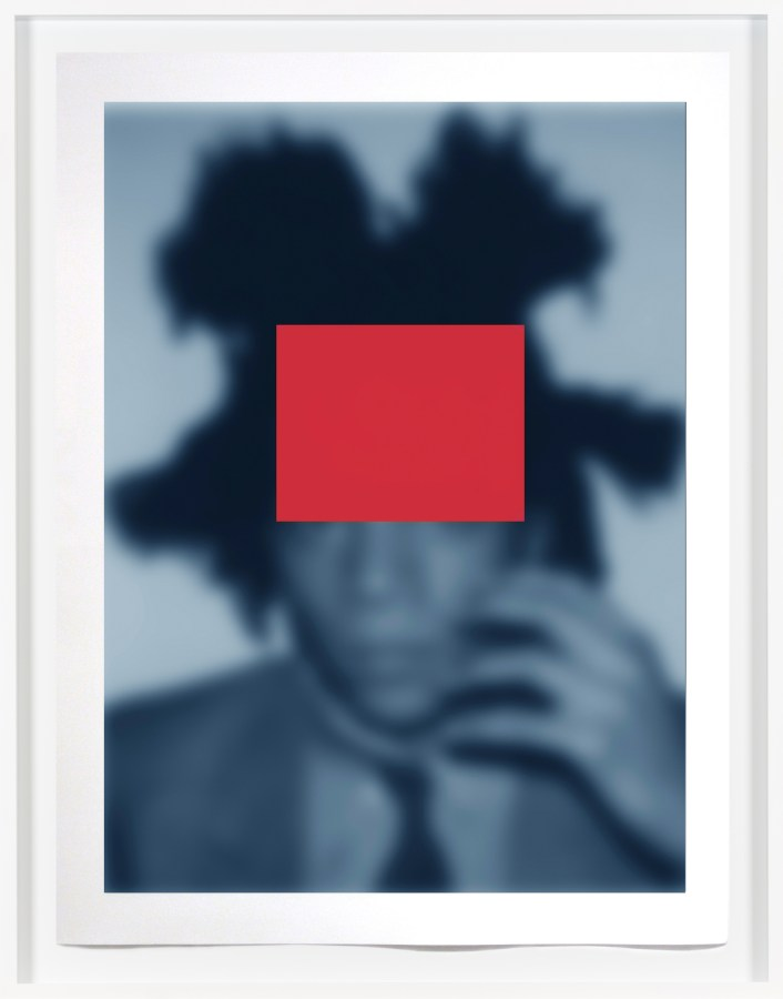 Framed artwork depicting a blue-toned, soft-focus portrait of Basquiat, with a red rectangle imposed over the top half of the artist's head.
