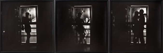 Three framed black and white photographs. In the first, an African American woman stands silhouetted in a doorway; in the second, an African-American man appears outside of the door; in the third, the two embrace, silhouetted in the doorway.